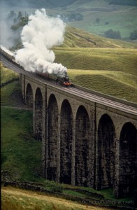 09 Flying Scotsman, Carlisle to Settle line - At the time you never knew if and quite when a loco would come or what the weather and wind conditions would be. At Arten Gill Viaduct there's a climb to this view. First ever photo of the loco on the famous line - under threat of closure at the time (before saved by Michael Portillo). Flying Scotsman came out of a distant tunnel, disappeared then reappeared before majestically crossing the viaduct. I pre-planned a sequence of horizontal and vertical shots and you had to resist the temptation to look away from the eyepiece at the live action in great scenery.